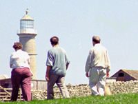 Day-trippers walking towards the Old Light